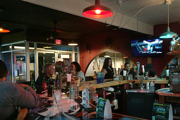 At Mosa's Joint in Guam, island residents and military personnel fill up the bar for Thursday happy hour.