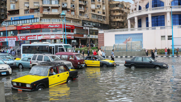 Drivers maneuver through floodwater after a torrential rain in Alexandria, Egypt.
