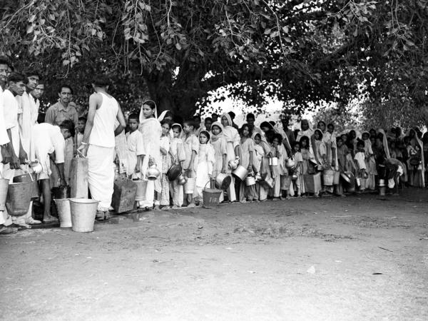 Muslim refugees, evacuated from areas of unrest in New Delhi, queue up for water at New Delhi's Old Fort in September 1947.