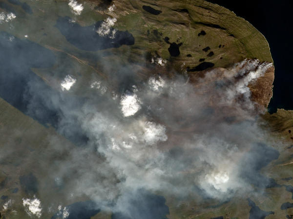 The wind direction from the fire in western Greenland has largely blown smoke toward the island's ice sheet and away from communities.