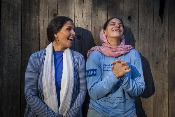 Amira Quraishi (left) and Asifa Quraishi-Landes are among the next generation that now runs the camp founded by their parents.