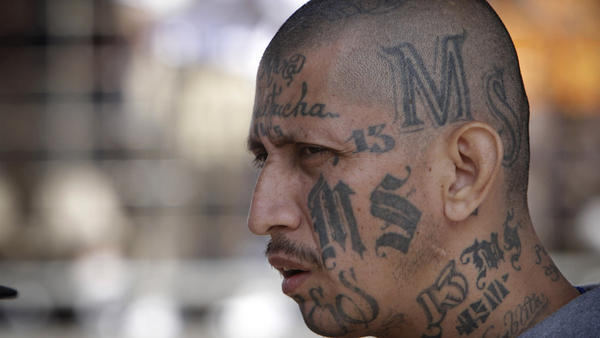 An MS-13 gang member at a prison in Salvador. As the gang spread from Central America to the U.S., authorities say its symbols became more subtle.