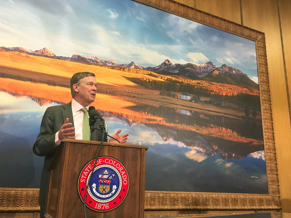 Colorado Gov. John Hickenlooper, seen here at a March 29 press conference on air pollution, is proposing more regulations on the oil and gas industry.