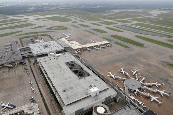 Planes are parked at George Bush Intercontinental Airport in Houston on Tuesday. The airport, which had been closed since Hurricane Harvey made landfall, opened with limited service on Wednesday.