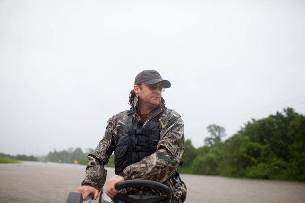 Troy King navigates his boat through a flooded portion of Highway 90 in Houston on his way to rescue the Galvan family.
