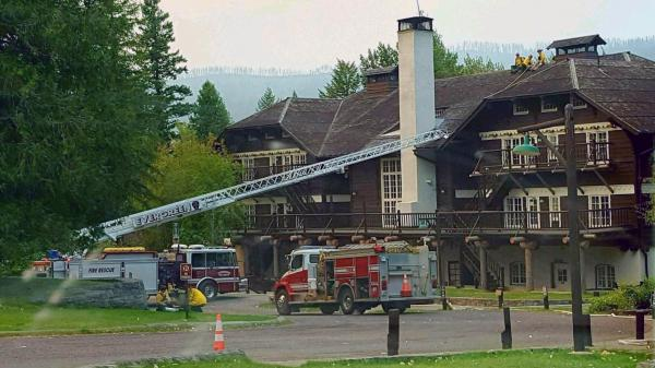 A fire truck is positioned outside Lake McDonald Lodge in Glacier National Park, Mont., on Sunday as firefighters prepare for a blaze that is threatening the century-old Swiss chalet-style hotel.