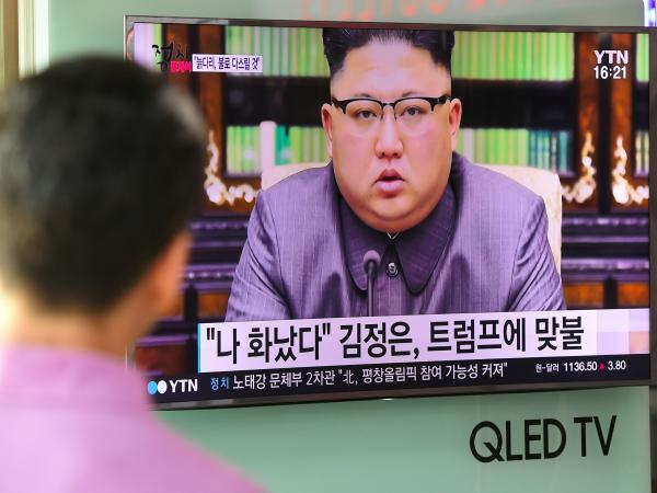 A man at a railway station in Seoul watches as North Korean leader Kim Jong Un delivering a statement in Pyongyang.