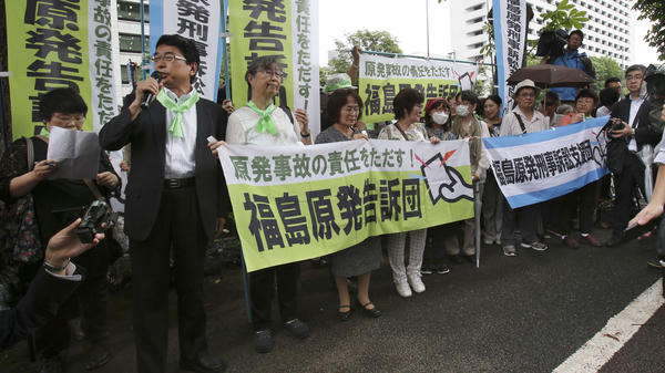 A Japanese court has ruled against the government in the largest case yet over the Fukushima nuclear disaster. In this file photo from June, plaintiffs of civil lawsuits held a rally in front of Tokyo District Court prior to the start of a criminal trial over the disaster.
