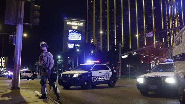 Police officers block a stretch of street in front of the Mandalay Bay Resort and Casino on the night of the shooting in Las Vegas.