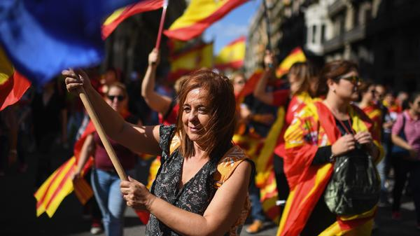 A Pro-Unity rally marches through Barcelona on Sunday, a week after a referendum on independence.