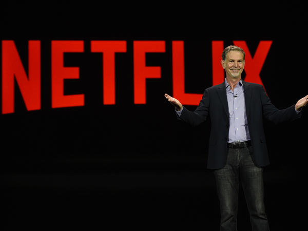 Netflix CEO Reed Hastings delivers a keynote address at CES 2016 in Las Vegas. He has admitted facing Amazon in video is a challenge.
