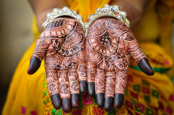 Henna tattoos decorate a bride's hands. A new ruling by the Supreme Court of India says that sex with any underage girl, even if she's a bride, is considered an act of rape. So child brides age 15 to 18 now have the same legal protection that younger girls do.