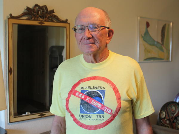 Retired EEOC attorney Bob Harwin wears a T-shirt made to celebrate winning a 1986 discrimination case against Pipeliners Local 798.