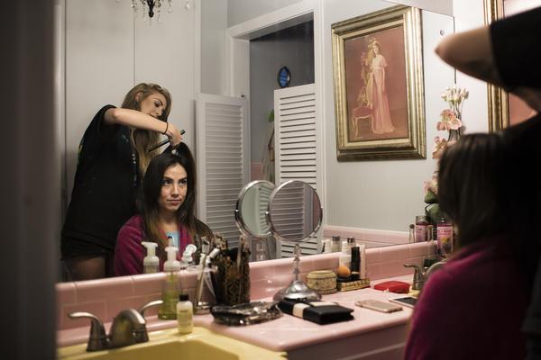Claudia De La Vega has her hair done the night before her wedding.