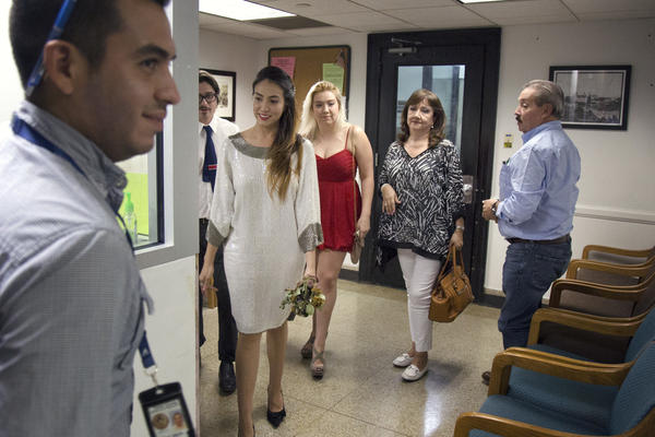 The De La Vega family walks into the Austin courthouse where Claudia and Marc will marry.