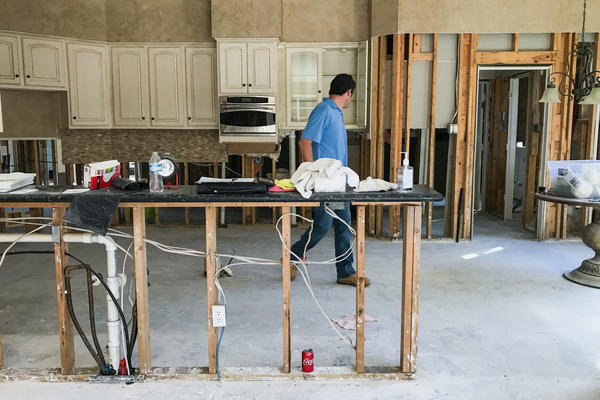 Corey Boyer, a real estate investor, inspects the kitchen of a house flooded after Hurricane Harvey in Humble, Texas.
