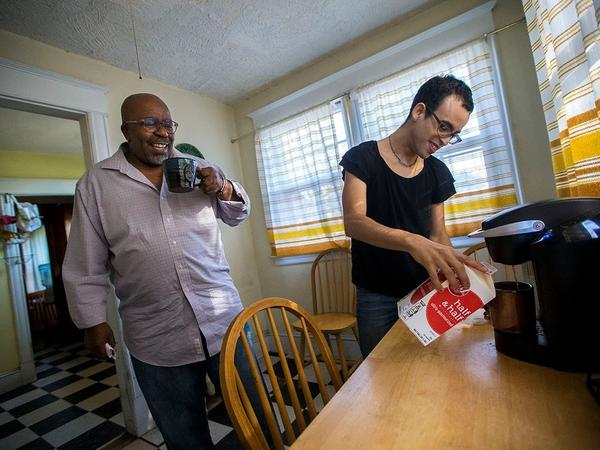 Louis Mitchell and Rivera have coffee together in the kitchen of their house in Springfield, Mass. Many days, to avoid threats and stares, Rivera does not leave the house.