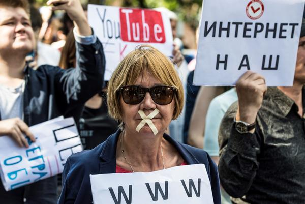 Protesters take part in the March for Free Internet in Moscow in July. In addition to allegedly interfering with the U.S. election, Russia imposes limits on its own citizens' access to information, the Freedom of the Net report says.