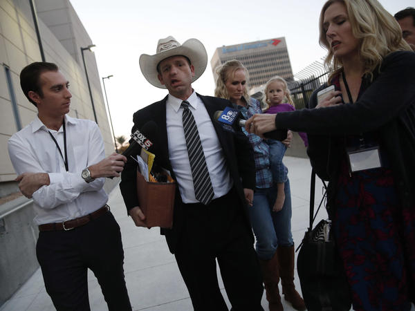 Ryan Bundy, one of Cliven Bundy's sons, walks out of federal court Tuesday in Las Vegas.