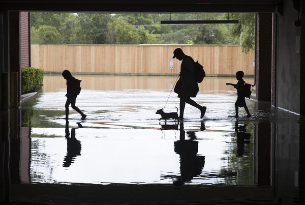 A family evacuated their apartment complex in west Houston, where high water coming from the Addicks Reservoir flooded the area after Hurricane Harvey on Aug. 30th.