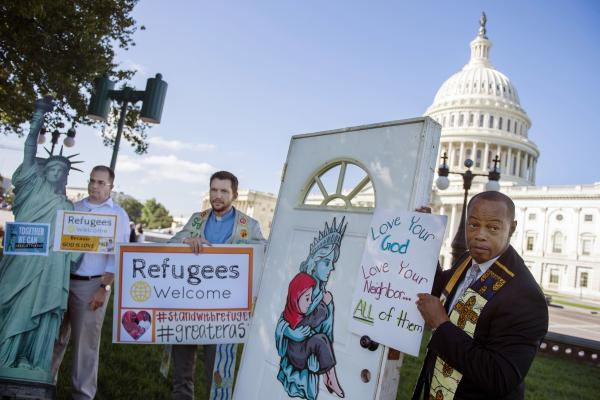 Religious leaders and activists from Church World Service hold up a door, closed to refugees, during a protest urging congress to pressure US President Donald Trump to allow more refugees to enter in front of the Capitol in September.