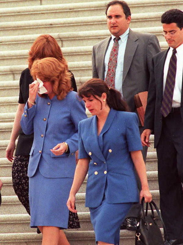 Members of Sen. Bob Packwood's staff walk down the Capitol steps after he resigned on the Senate floor in Washington, D.C., on September 7, 1995