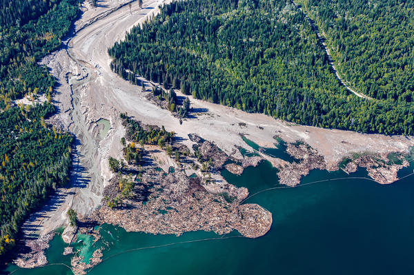 Debris poured into Quesnel Lake after the Tailings Pond breach of Mount Polley Mine in British Columbia, Canada, in 2014.