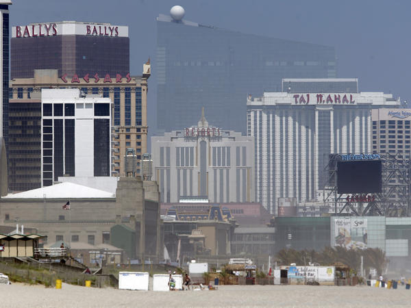 Casinos are seen along the boardwalk in Atlantic City, N.J., in June. In the background is the former Revel Casino.