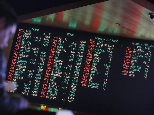 Odds are displayed on a screen at a sports book owned and operated by CG Technology in Las Vegas in 2015.