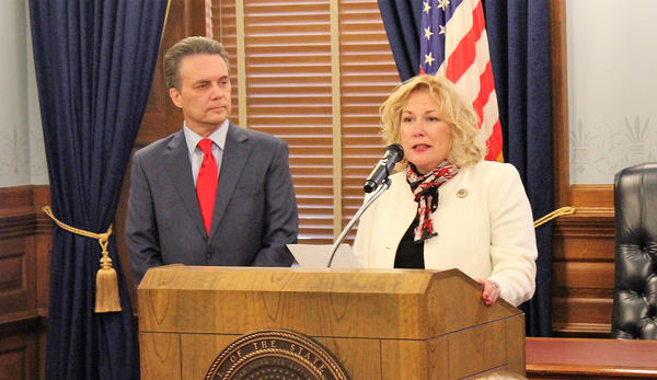 Gina Meier-Hummel, right, started her job Friday as secretary of the Kansas Department for Children and Families. She was appointed by Lt. Gov. Jeff Colyer, left.