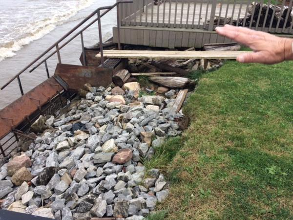 Lawn along Lake Ontario has been eroded by waves.