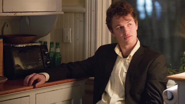 In A Blazer of Glory: Preppy Addison (Ansel Elgort) preps to investigate a murder in <em>November Criminals</em>.
