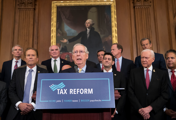 Senate Majority Leader Mitch McConnell, R-Ky., center, joins Speaker of the House Paul Ryan, R-Wis., and other GOP lawmakers to talk about the GOP tax plan.