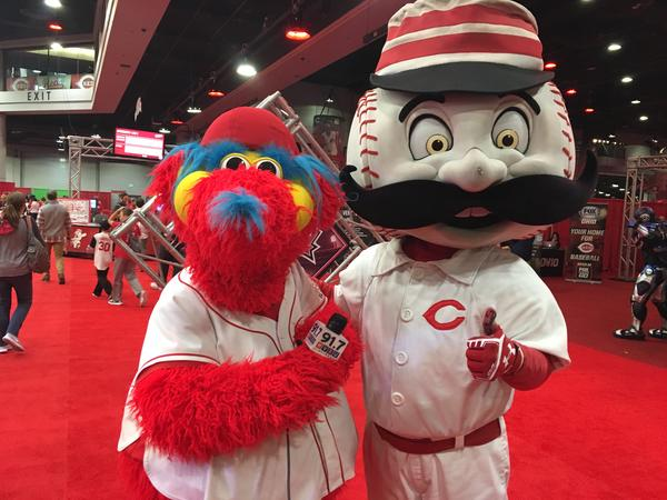 Gapper and Mr. Redlegs hold the WVXU mic at Redfest.
