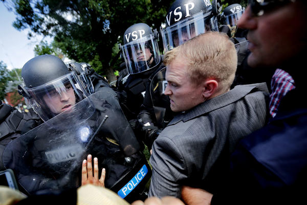 "White nationalists clash with police as they are forced out of Emancipation Park after the ""Unite the Right"" rally Aug. 12 in Charlottesville, Va."