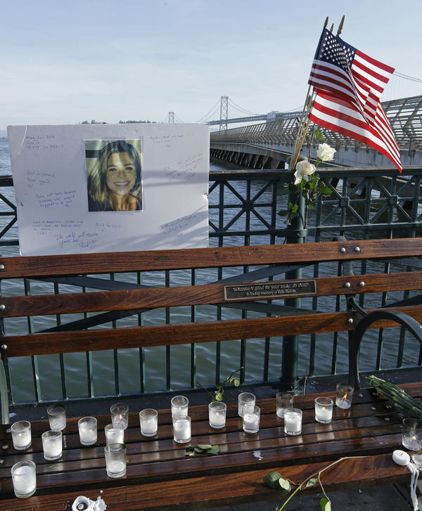 Flowers and a portrait of Kate Steinle remained at a memorial site on a San Francisco pier on Friday. Her 2015 killing became a focus for anti-sanctuary-city campaigners, including then-candidate Donald Trump.