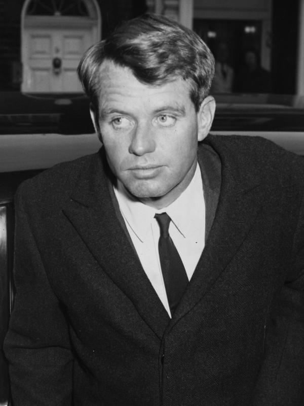 Attorney General Robert Kennedy arrives at the home of Princess Lee Radziwill, sister of Jackie Kennedy, on Jan. 24, 1964.