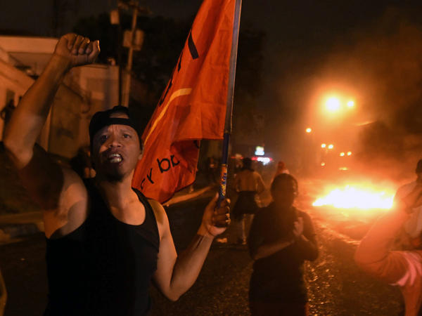 Supporters of Salvador Nasralla set a barricade alight during a protest outside the Electoral Supreme Court (TSE), to demand the announcement of the election final results in Tegucigalpa on Thursday.
