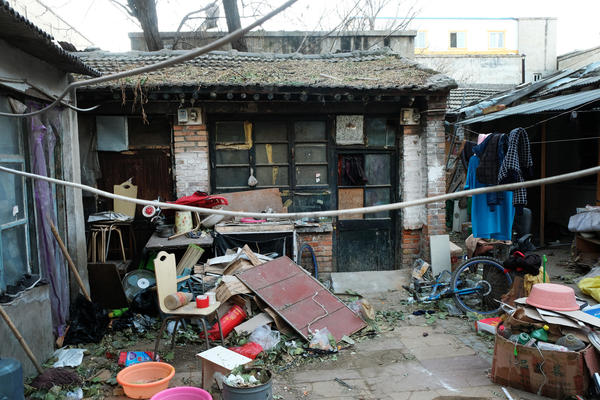 Debris is left behind after migrants moved out of a building in the Jiugong Township of Beijing.