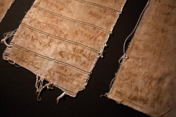 """Pieces of cloth that Omari and other inmates used to document the names of the """"disappeared"""" imprisoned with them. They made ink out of blood from their bleeding gums and rust from the prison bars."""