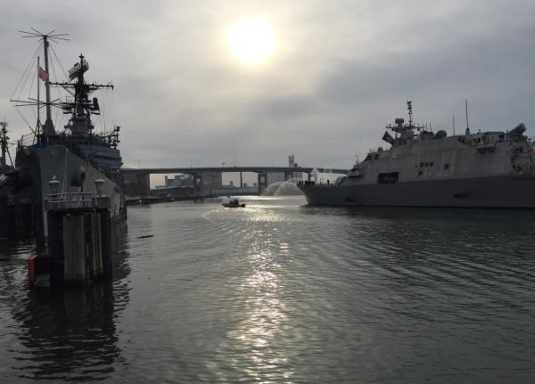 Old Meets New: Docents on the original USS Little Rock exchange salutes with the crew of the new USS Little Rock as the latter arrives in Buffalo in advance of its commissioning ceremony, scheduled for December 16.