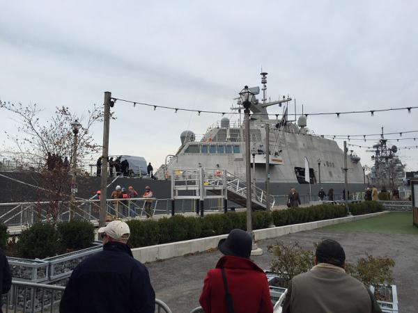 Bystanders watch as the new USS Little Rock LCS9 is secured at Canalside. The naval vessel will be officially commissioned on December 16 in Buffalo, alongside the decommissioned original Little Rock.