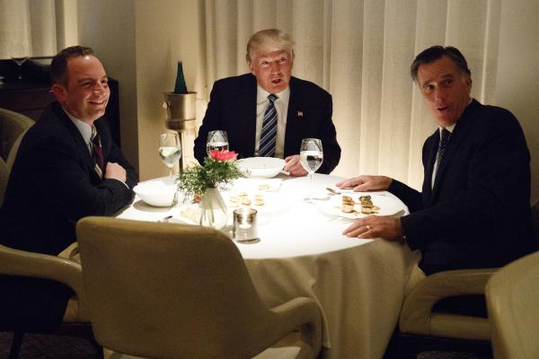 President-elect Donald Trump eats dinner with Mitt Romney and then-incoming White House chief of staff Reince Priebus at Jean-Georges restaurant at the Trump International Hotel in New York, in November 2016.