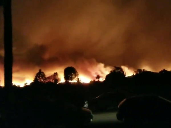 A wildfire rages in Ventura County, Calif., on Tuesday in this still image taken from social media video.