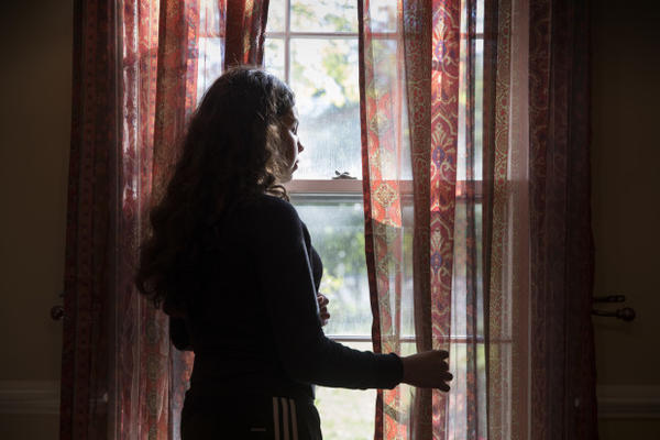 <p>Estefany Velasquez, 13, has suffered from asthma for the last decade. Location: Silver Spring, Maryland. Here Estefany poses at one of the windows in her home. Although she likes to play soccer, her asthma is triggered by many outside environmental factors, so she finds it easier to spend time indoors.</p>