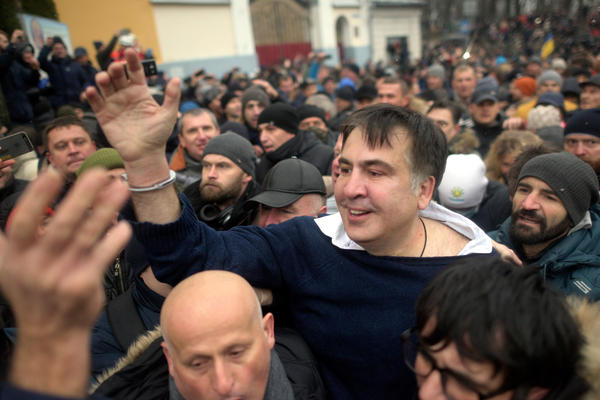 Former Georgian President Mikhail Saakashvili (center) greets his supporters after escaping a van headed for jail in Kiev on Tuesday.
