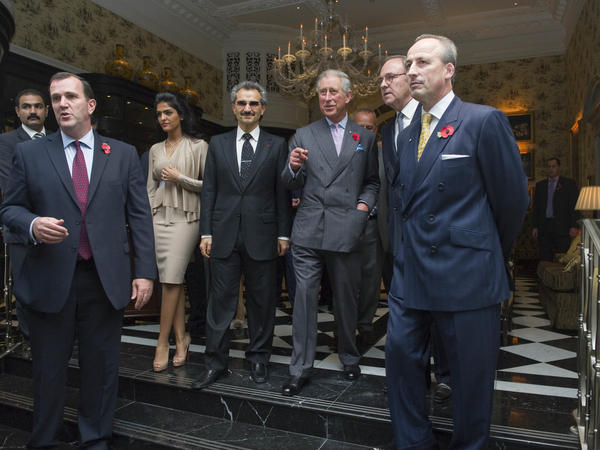 Prince Alwaleed Bin Talal (fourth from left) attends the reopening of London's Savoy Hotel in 2010 with Prince Charles.