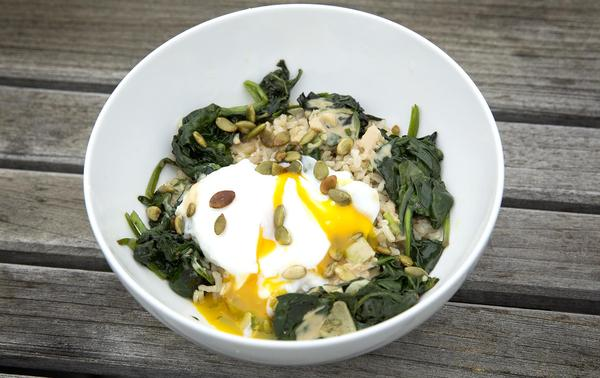Kathy's healthy rice bowl with sauteed greens, poached egg and pumpkin seeds, with a tahini-ginger sauce. (Robin Lubbock/WBUR)