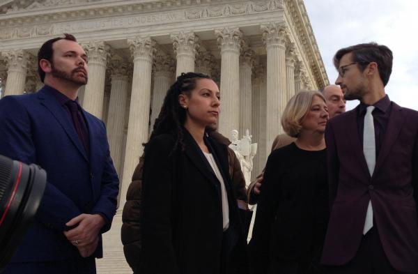 Charlie Craig, Ria Tabacco Mar of the ACLU, Deborah Munn (mother of Charlie Craig) and Dave Mullins in front of the Supreme Court on Tuesday. Craig and Mullins are the couple refused a wedding cake by Phillips.