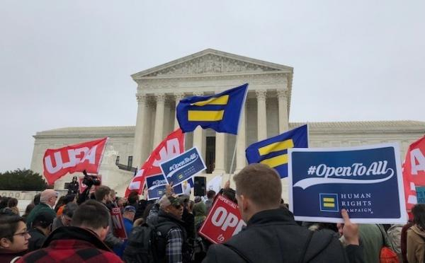 Demonstrators gather outside the Supreme Court on Tuesday as the justices heard arguments in a case about a Colorado baker who refused to create a cake for a same-sex wedding, citing moral objection.